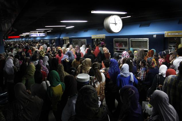 Egyptian women board a car at the Shohadaa (Martyrs) metro station in Cairo. Credit: Heba Elkholy/ AP
