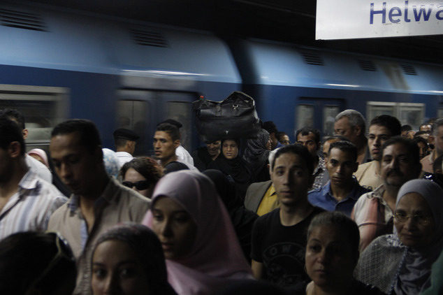 Passengers departing the metro at the Shohadaa (Martyrs) station, where the first and second lines intersect. Credit: Heba Elkholy/ AP