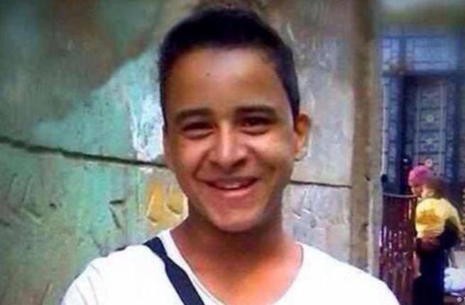 Mahmoud Mohamed, a 19-year-old who has been detained for wearing an 'anti-torture' t-shirt.
