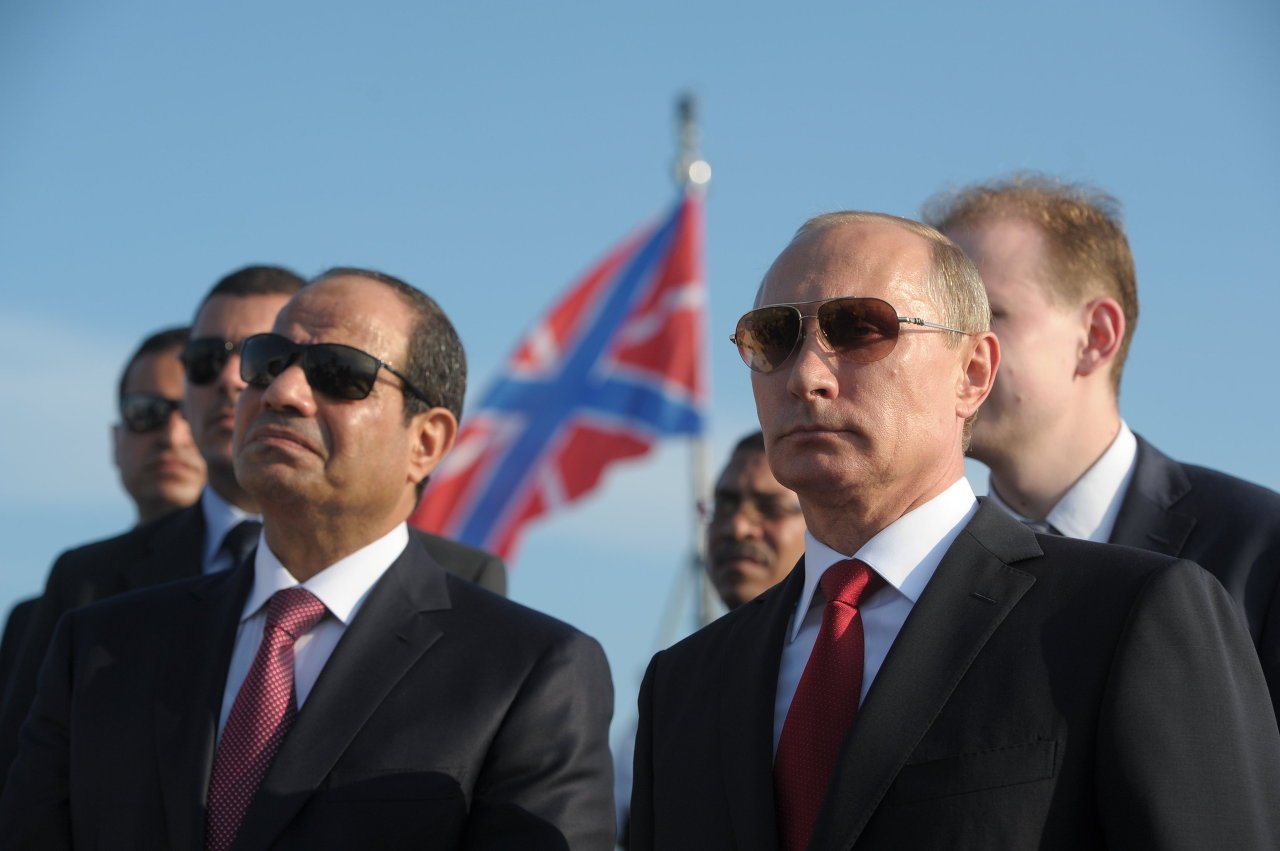 Russian President Vladimir Putin, right, and Egyptian President Abdel Fattah el-Sisi visit the Black Sea Fleet's missile cruiser Moskva on Aug. 12 in the sea port of Sochi. (Alexei Druzhinin / AFP)