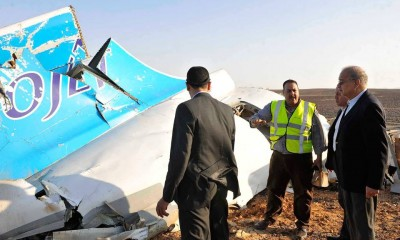Part of the Russian airplane that crashed in Egypt's North Sinai being inspected by Prime Minister Sherif Ismail. Credit: AP