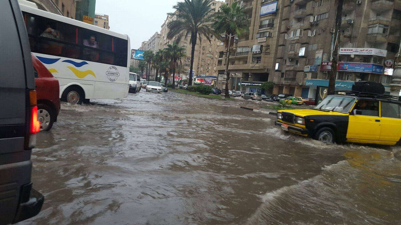 Public transportation making its way through several inches of accumulated rainwater in Alexandria. Photo: Reem Sami Abul Enain