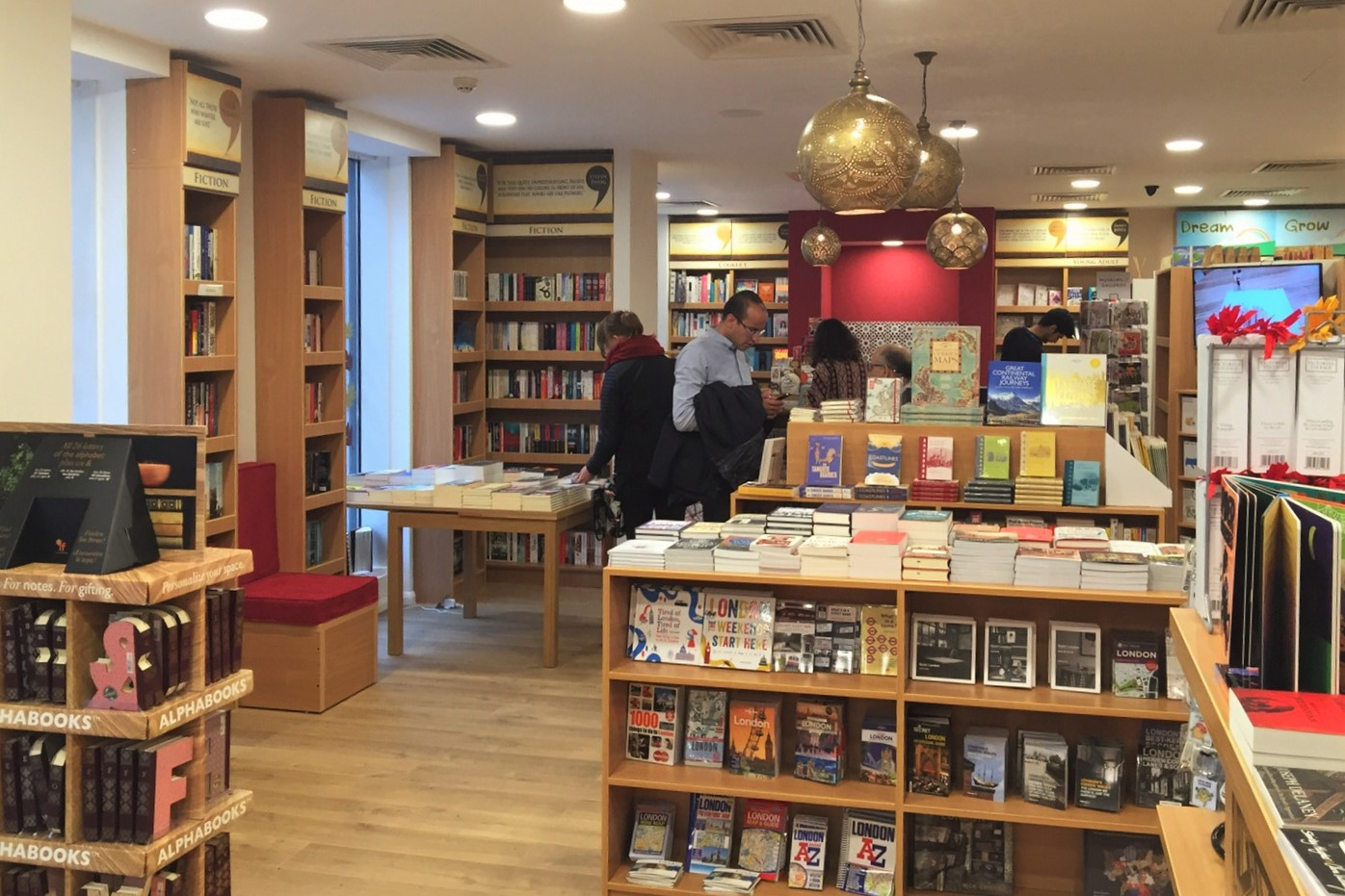Store visitors exploring the wide array of displayed books. Courtesy of Alef Bookstores