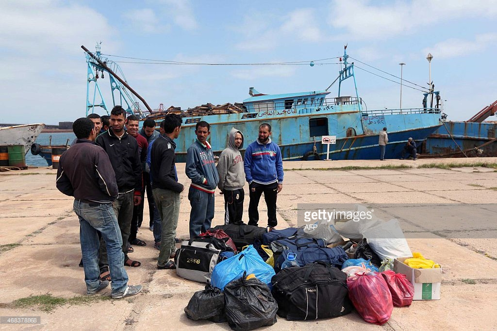Egyptian fishermen, who had entered the Libyan waters with out permission, gather at the port in the Libyan city of Misrata on April 2, 2015. Photo: Mahmud Turkia, AFP