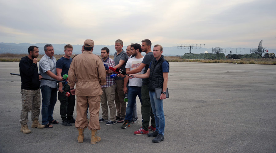 Rescued pilot of the Russian Air Force's Su-24 jet, Captain Konstantin Murakhtin, center, answers journalists' questions at Khmeimim Air Base in Latakia. Dmitriy Vinogradov/Sputnik