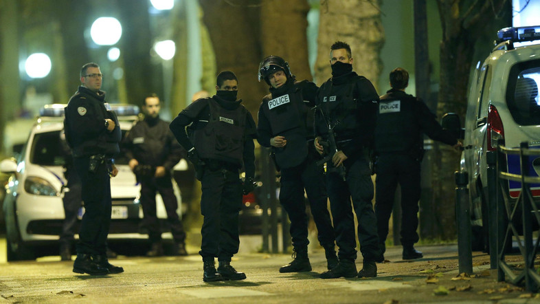 French special police forces secure the area as shots are exchanged in Saint-Denis, France, near Paris, November 18, 2015 during an operation to catch fugitives from Friday night's deadly attacks in the French capital. REUTERS/Christian Hartmann