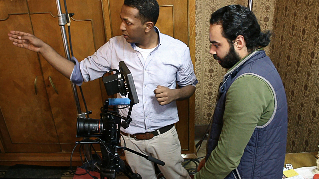 Karim Shaaban (left) and Habby Khalil (right) amid an on-set discussion. Courtesy of Karim Shaaban.
