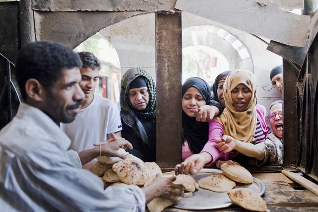 Egyptian women line up outside a local bakery. Credit: Shawn Baldwin/ Bloomberg