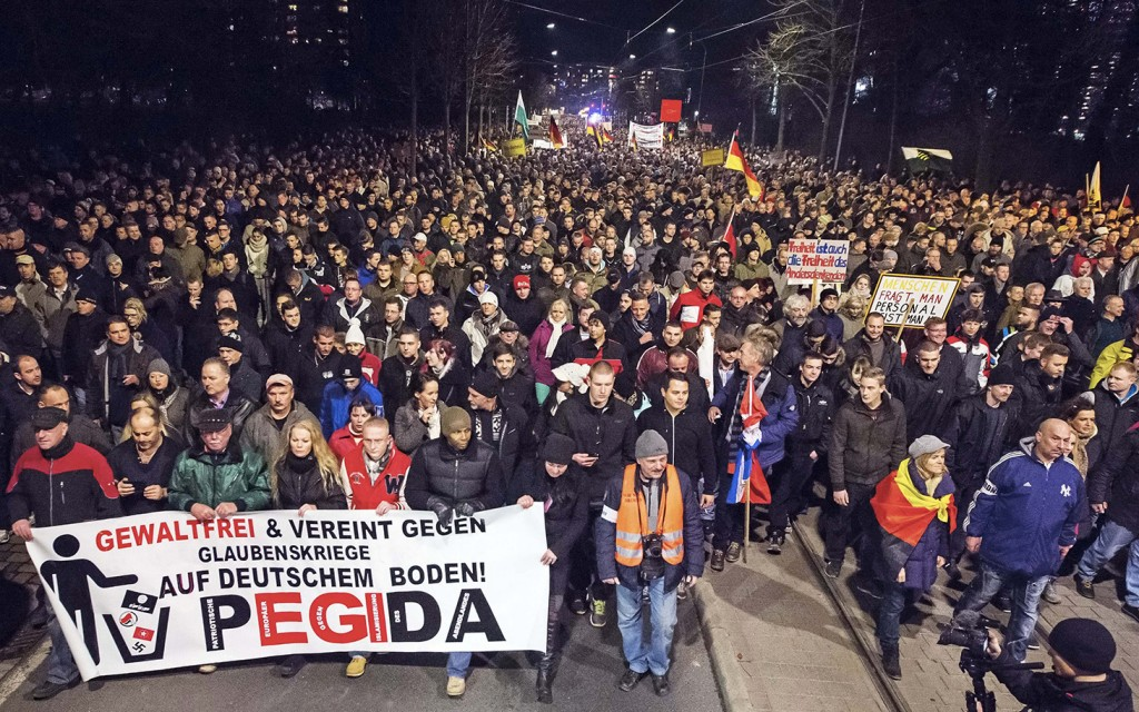 Thousands of participants of a rally called 'Patriotic Europeans against the Islamization of the West' (PEGIDA) gather in Dresden, eastern Germany, Monday, Dec. 15, 2014. (AP Photo/Jens Meyer)