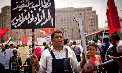 Laborers marched to Tahrir Square and the neighboring Shura Council during the Labour Day 2013. Credit: Virginie Nguyen