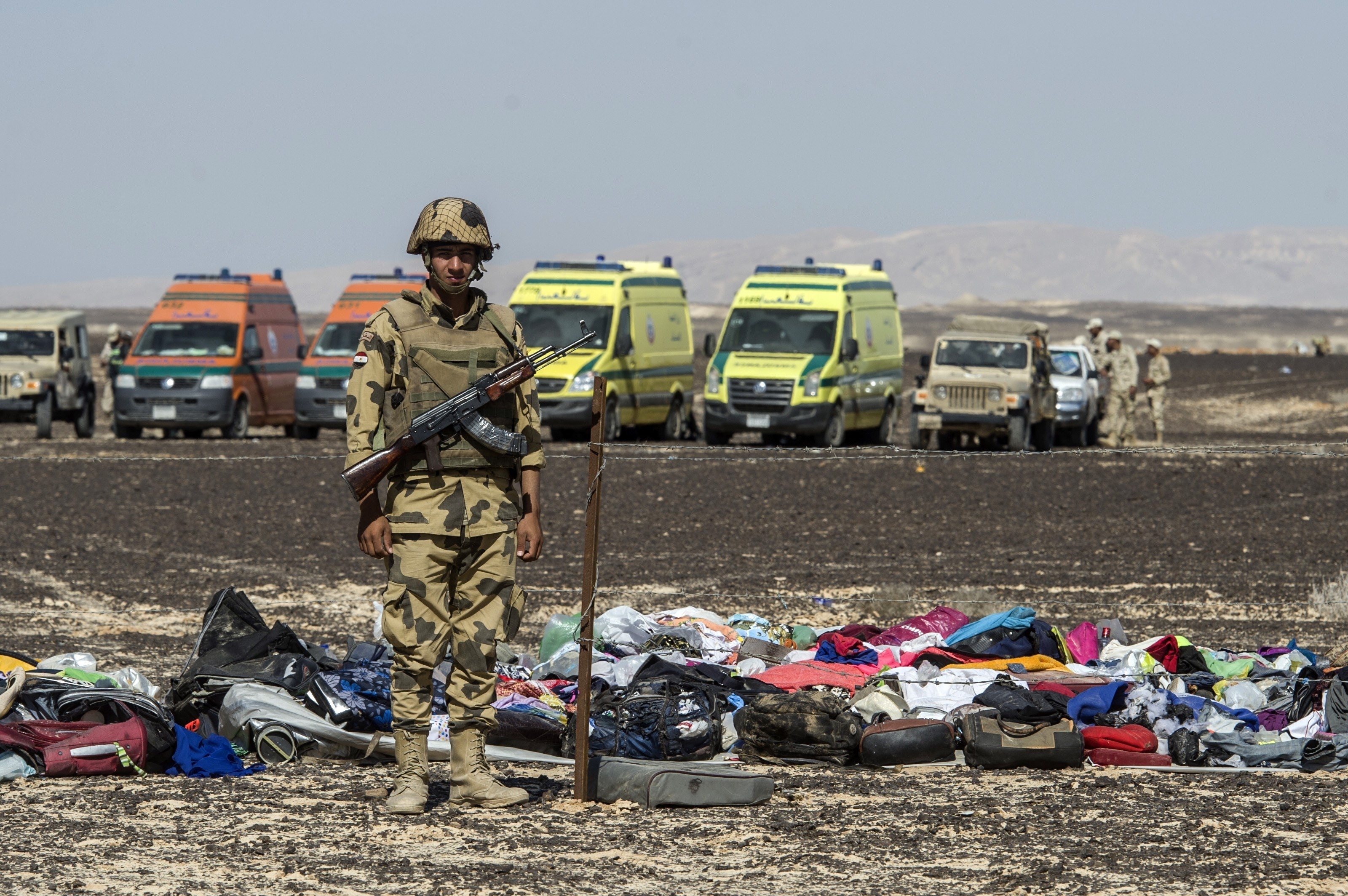 An Egyptian army soldier stands guard next to the luggage and belongings of passengers of the A321 Russian airliner piled up at the site of the crash in Wadi al-Zolomat, a mountainous area in Egypt's Sinai Peninsula on November 1, 2015.(KHALED DESOUKI/AFP/Getty Images)