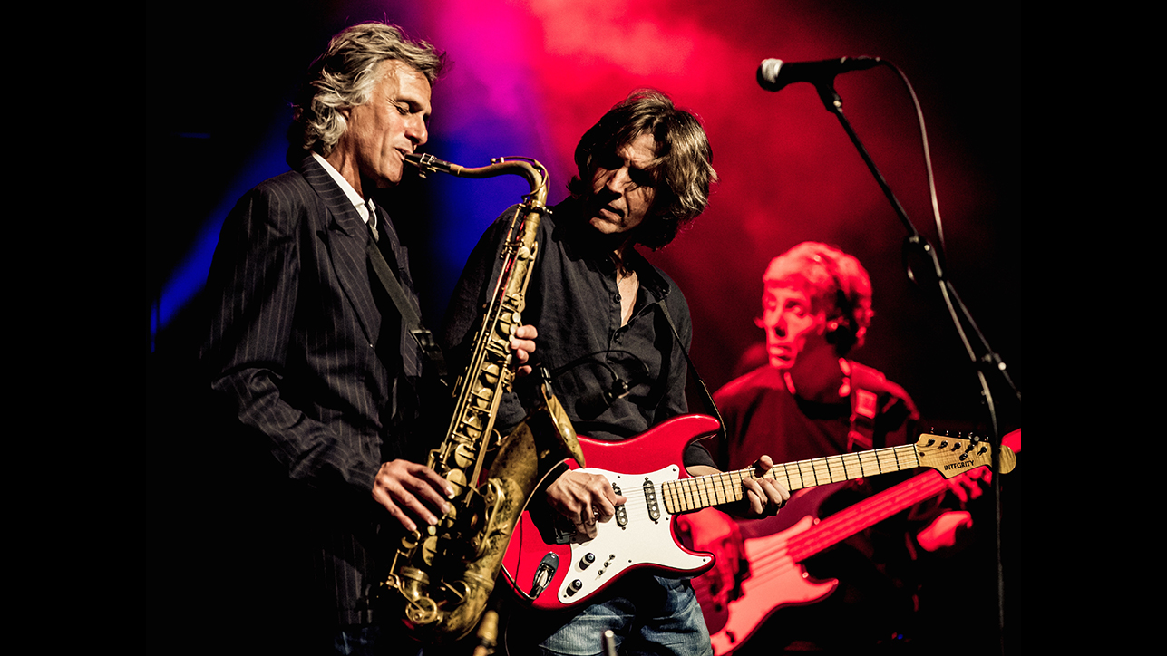 Chris White and Terence Reis during 'The Dire Straits Experience' world tour. Source: The Dire Straits Experience website