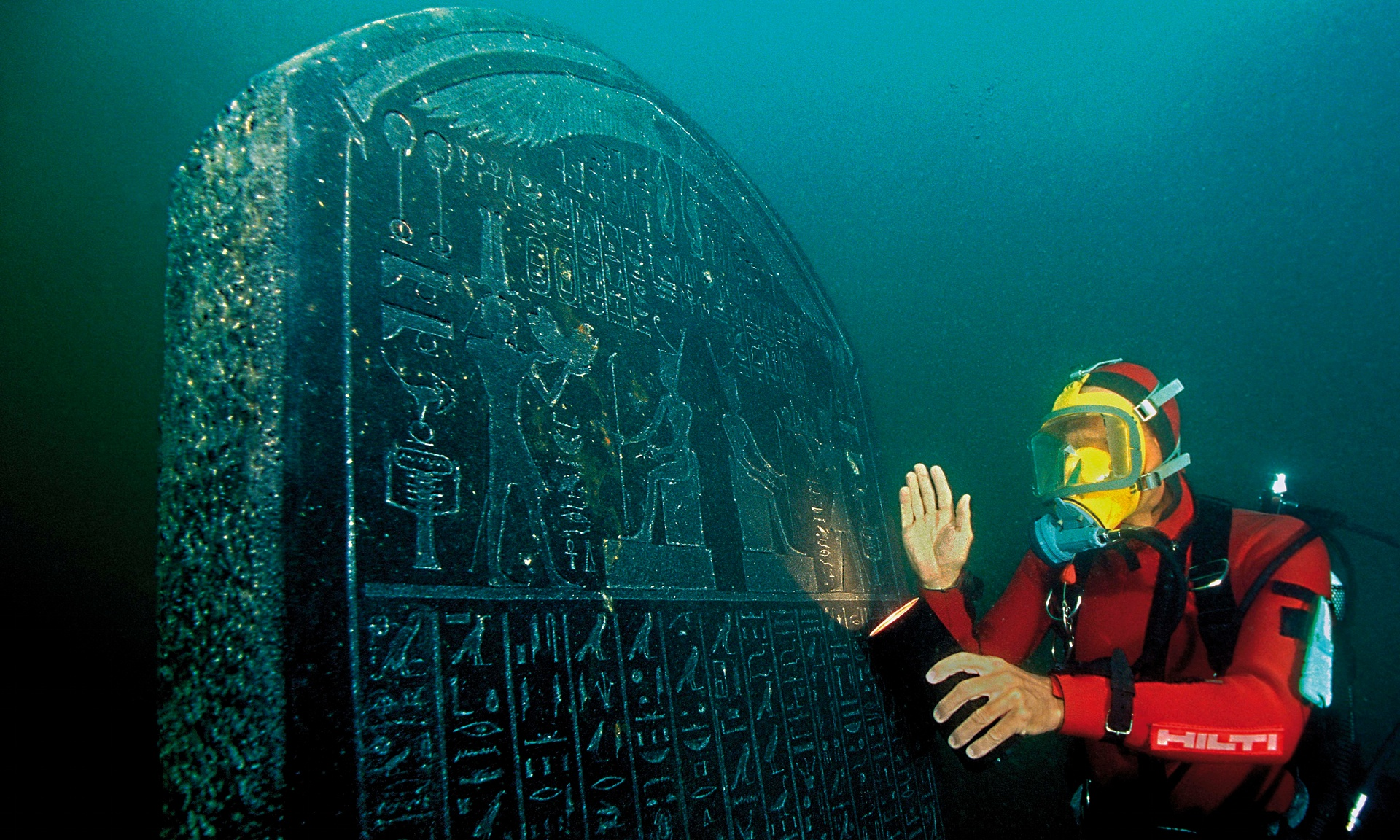 A diver with a large tablet carrying a royal decree from the pharaoh Nectanebo I, which will feature in the British Museum exhibition. Photograph: Christoph Gerigk/Franck Goddio/Hilti Foundation