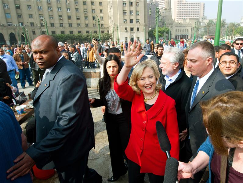 Hillary Clinto nwaves as she walks through Tahrir Square during her visit in Cairo March 16, 2011. REUTERS