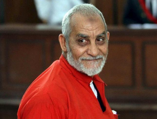 Mohamed Badie, top leader of Egypt's outlawed Muslim Brotherhood, talks during a trial hearing alleging his involvement in a 2013 attack on a Port Said police station, at a court in Cairo, April 20, 2015. REUTERS/Al Youm Al Saabi Newspaper