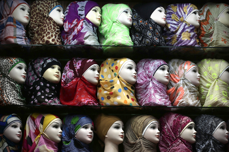 Mannequins wrapped in Islamic headscarves. Credit: Hassan Ammar/ AP