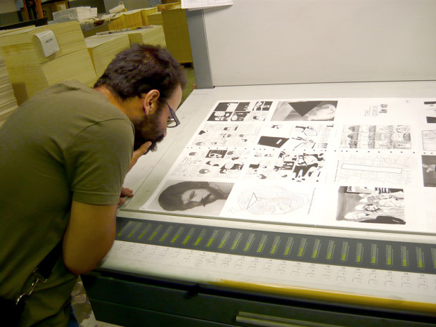 Omar Khouri inspecting the printing