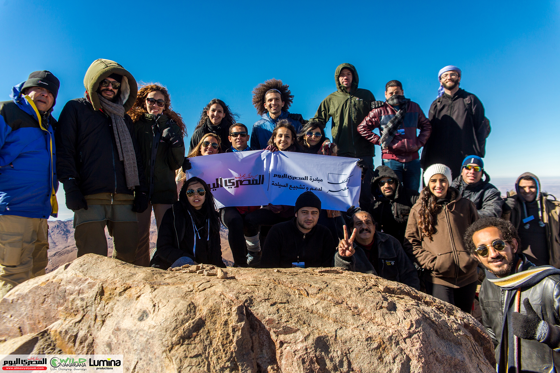 Omar Samra, journalists from AMAY and other public figures at the summit of Mount St Catherine. Credit: Lumina Productions