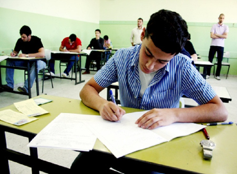 A secondary school student taking his exam in Egypt