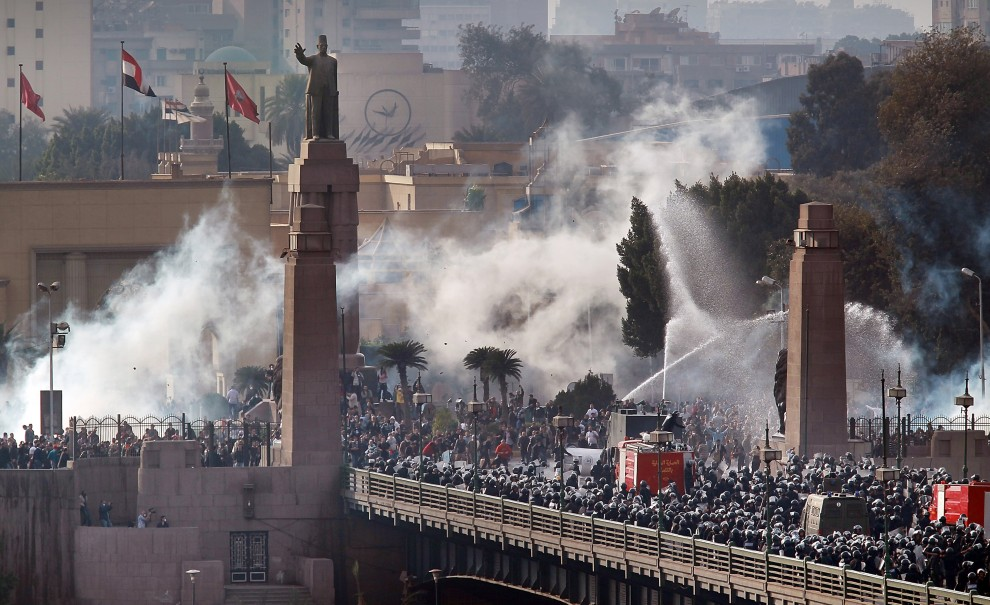 Security forces and protesters clash during the January 25 revolution in 2011.