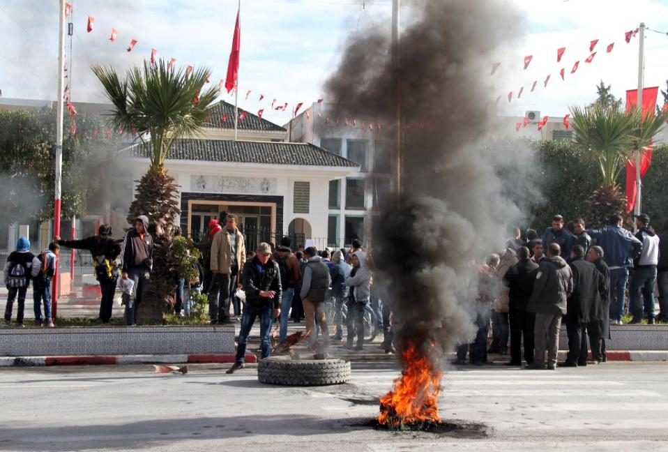 Daily protests and clashes with security forces in the town of Kasserine have followed the death on Saturday of an unemployed man who was electrocuted atop a power pole near the governor's office. Photo: Fawzi Dridi, AFP
