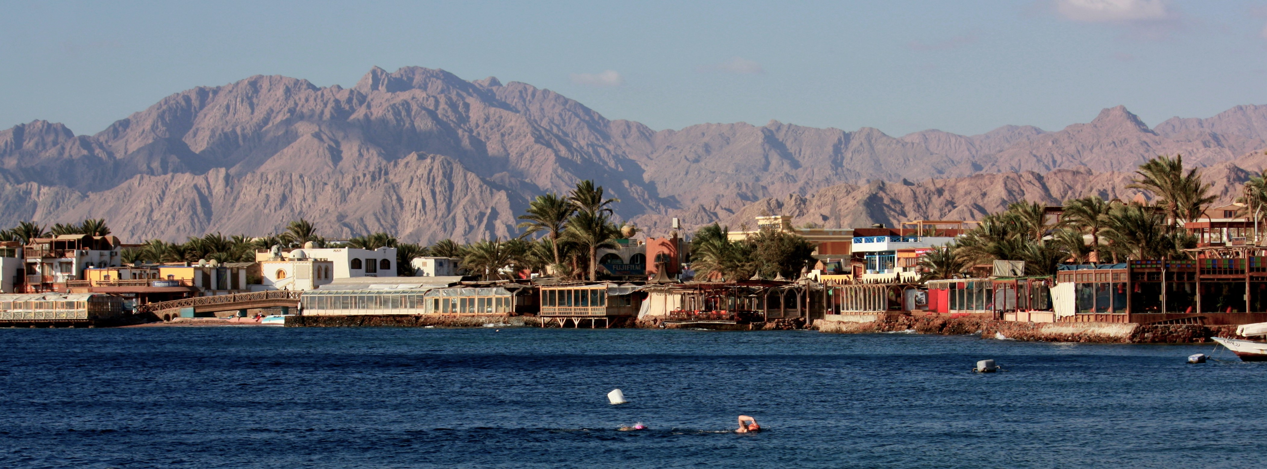 Inns and cafeterias lining the Red Sea in Dahab. Credit: Katia Vastiau