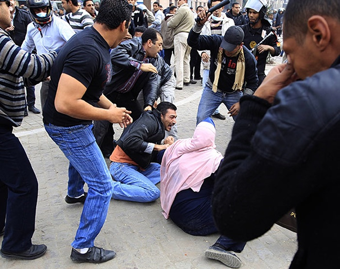 Plainclothes police beat protesters in Cairo. Photo: Goran Tomasevic, Reuters
