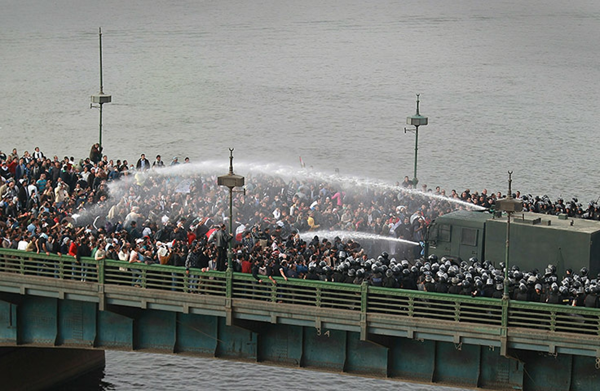 Riot police use water cannons on protesters trying to cross the Kasr al-Nile bridge. Photo: Peter Macdiarmid, Getty Images