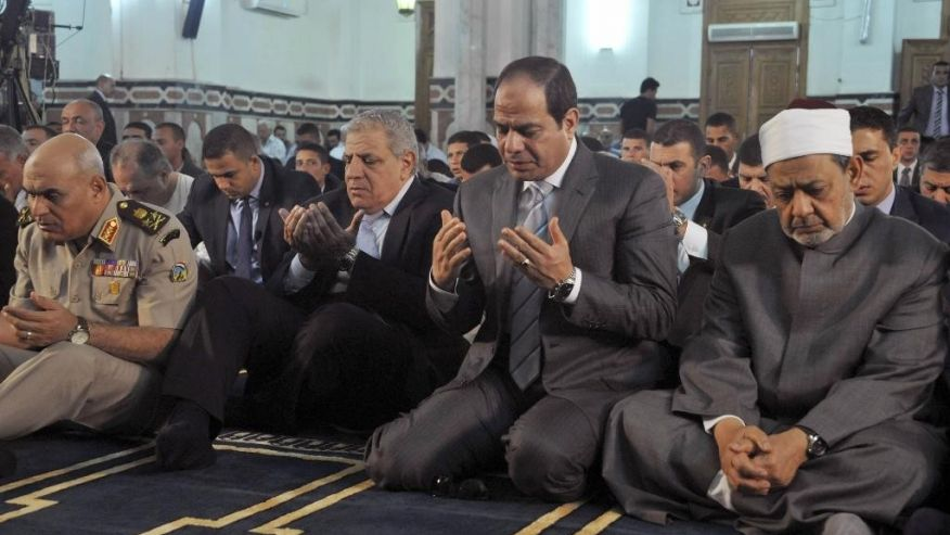 A photo released by Egypt's official Middle East News Agency (MENA) shows Egyptian President Abdulfattah Al-Sisi (second right), the Grand Sheik of Al-Azhar, Ahmed Al-Tayeb (right) and former Prime Minister Ibrahim Mehleb (center). Photo: Associated Press