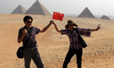 Chinese tourists posing in front of the Pyramids of Giza in Egypt. Credit Khaled Elfiqi/European Pressphoto Agency