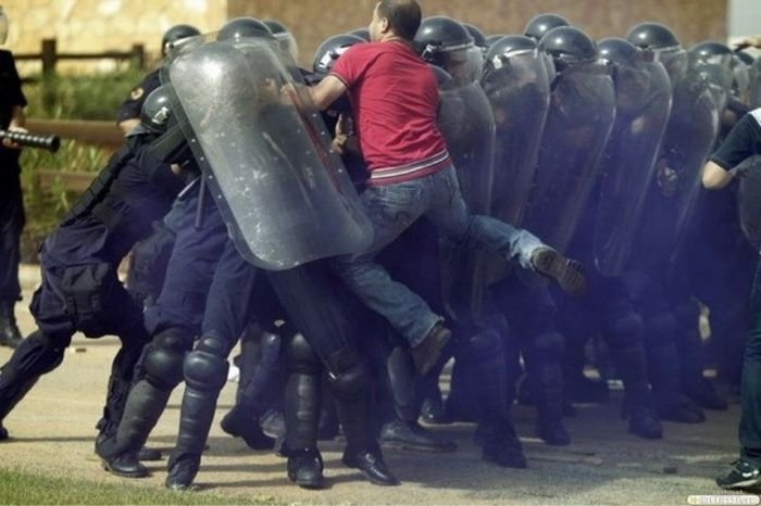 A protestor clashes with anti-riot police. Photo credit: unknown