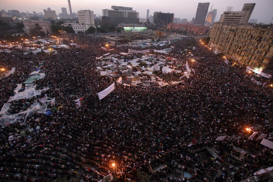 Egyptian anti-government protesters perform the evening prayers as they gather at Cairo's Tahrir square on February 8, 2011. Photo: Patrick Baz, AFP/Getty Images