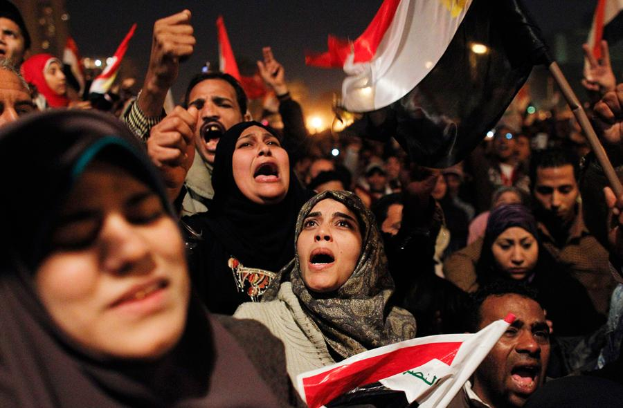 Egyptian women celebrate the news of the resignation of President Hosni Mubarak, who handed control of the country to the military, at night in Tahrir Square in downtown Cairo, Egypt Friday, February 11, 2011. Photo: Tara Todras-Whitehill, AP