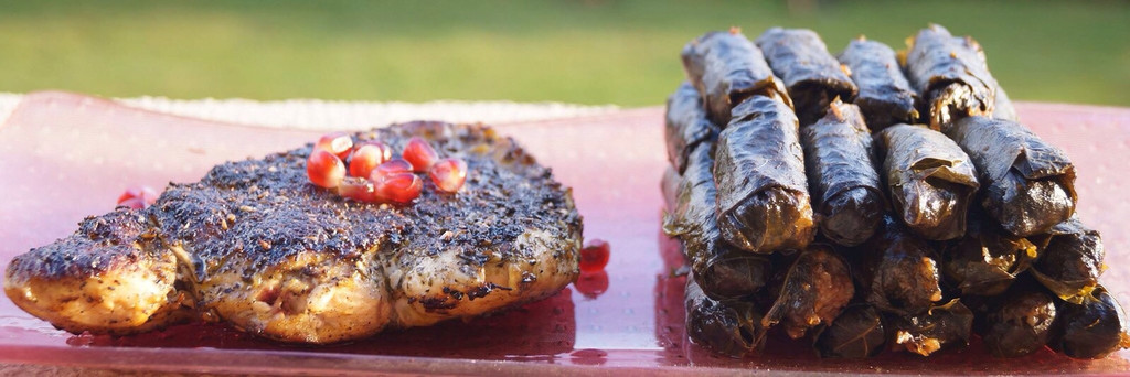 Roasted chicken with herbs and vine leaves with pomegranate concentrate for EGP 45.