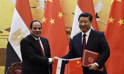Egypt's President Abdel Fattah al-Sisi (L) shakes hands with Chinese President Xi Jinping during a signing ceremony in the Great Hall of the People in Beijing December 23, 2014.   REUTERS/Greg Baker/Pool