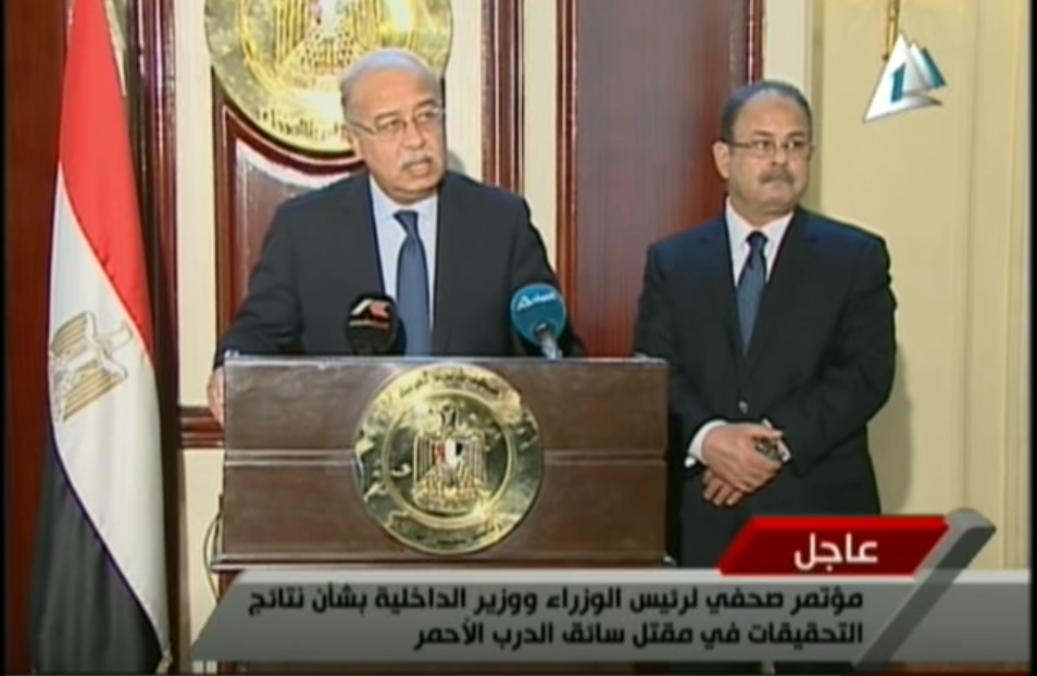 Prime Minister Sherif Ismail (left) at a press conference with Minister of Interior Magdy Abdel Ghaffar (right)