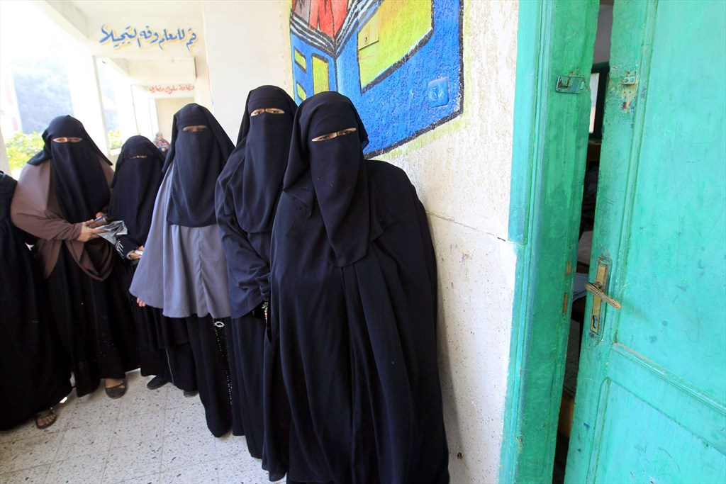 Niqab-clad women line up to vote during a 2014 election. Credit: Mohammed Abed/AFP