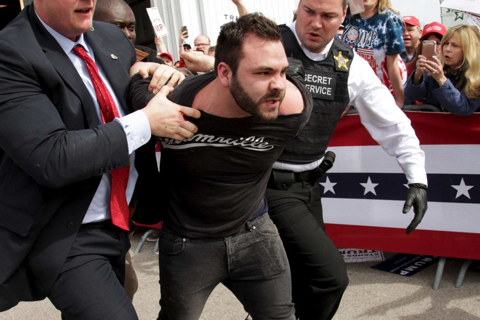 US Secret Service agents escorted the man out of the venue. Reuters: William Philpott