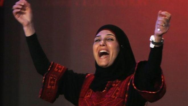 Al Hroub accepting her award (AP).