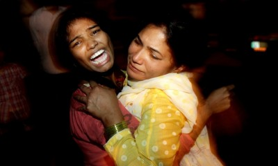 Women comfort each other following the attack in Lahore.