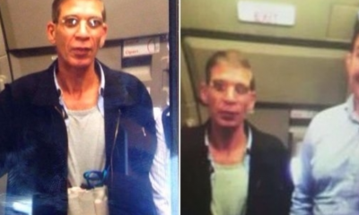 The hijacker takes a photo with a hostage