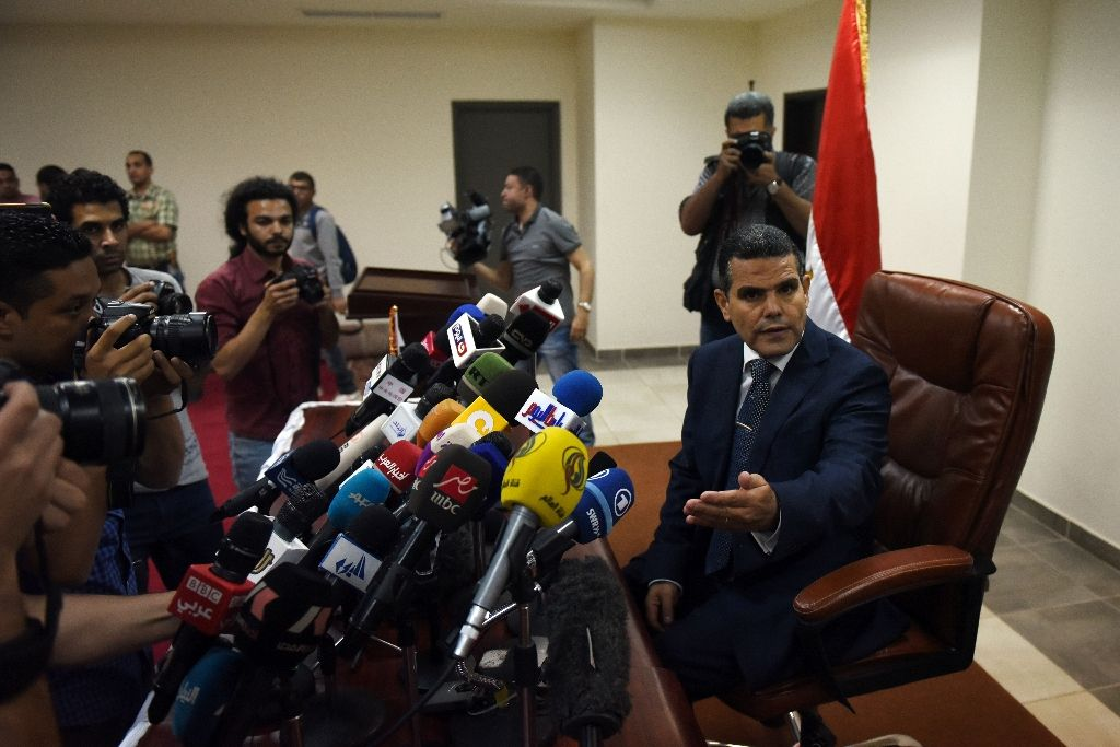 Mostafa Suleiman (R), Egypt's assistant state prosecutor, speaks to the press in the capital Cairo on April 9, 2016, on the subject of the murder of student Giulio Regeni (AFP Photo/Mohamed El-Shahed)