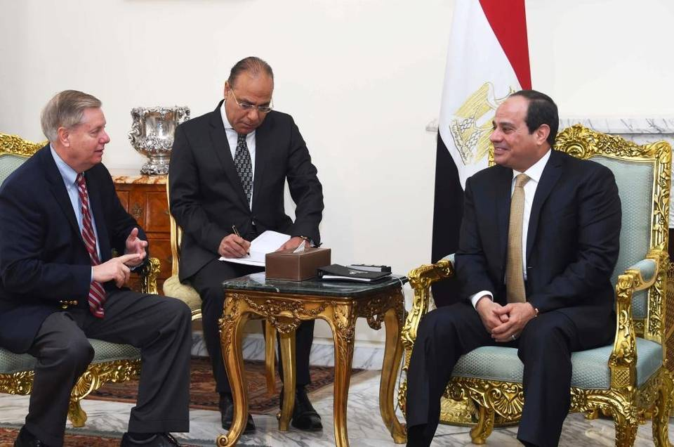 Egyptian President Abdel-Fattah el-Sissi meets with Republican Sen. Lindsey Graham (left) at the office of the presidency in Cairo.