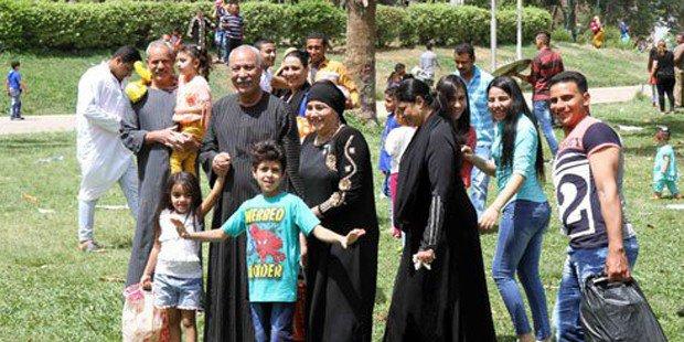A family enjoys an excursion at Al-Orman Park. Photo: The Cairo Post
