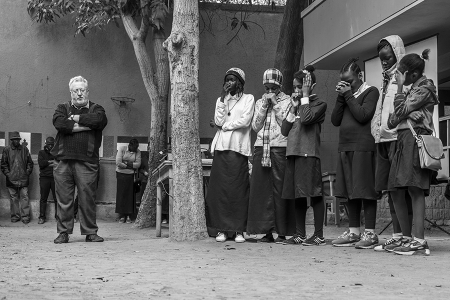 Students and teachers in the playground during morning prayers
