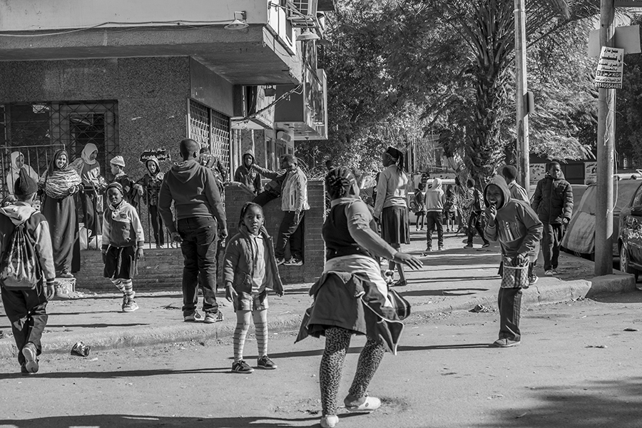 Students play in the street in front of the school after school time