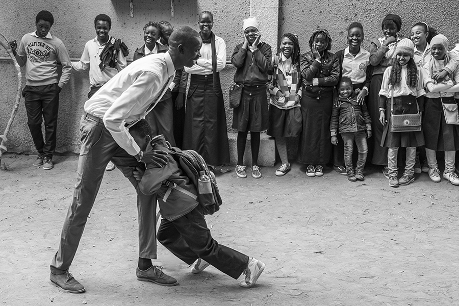 A teacher plays with one of the students in the playground