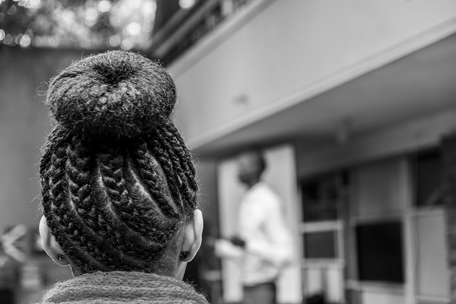 A girl stands in the morning line at AHLC displaying beautifully braided hair