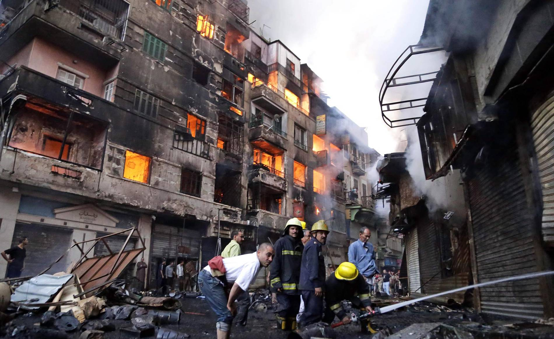 The fires continued on Monday in the buildings in Al-Rewaei while firefighters attempted it to put it off (Photo: AFP)