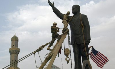 US troops chaining a statue of Saddam Hussein before pulling it down. Credit: Ramzi Haidar/AFP